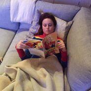 Brie Larson reading Captain Marvel book