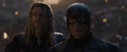 Thor and Captain America watch as Iron Man died