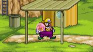 Wario grabbing the Gooey bomb