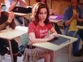 Gretchen Weiners sitting at her desk