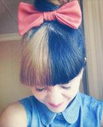 Melanie-martinez-blonde-black-hair-bun-1