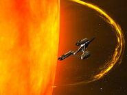 """USS Enterprise skims near Sol """"Using the slingshot effect*"""