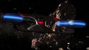 USS Enterprise (NCC-1701-D) enters asteroid field.jpg