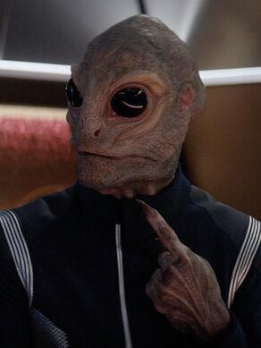 Lt. j.g. Linus, a male Saurian, in 2257