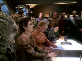 Female Changeling signs Treaty of Bajor.jpg