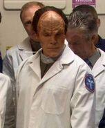Denobulan in lab coat