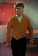 Charlie in beige wraparound tunic