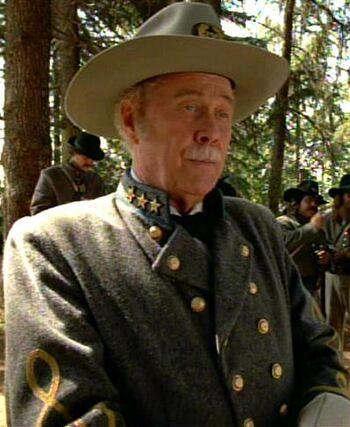 """Harve Presnell as """"Colonel"""" Q (1996)"""