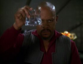 Benjamin Sisko toasts the good guys.jpg