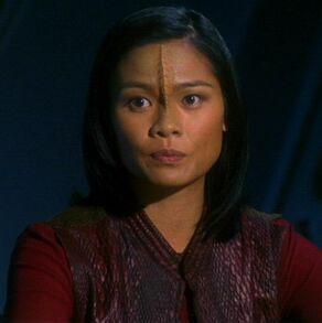 Karyn Archer, an individual with Ikaaran ancestry