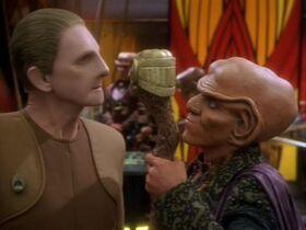 Quark tells Odo to kiss it.jpg