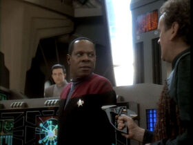 Smiley draws a phaser on Sisko.jpg