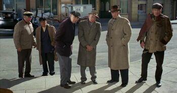 ...as a Street onlooker (far left)