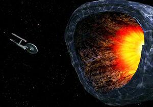 USS Enterprise tractored into planet killer, remastered.jpg