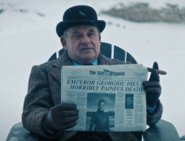 Carl holding The Star Dispatch