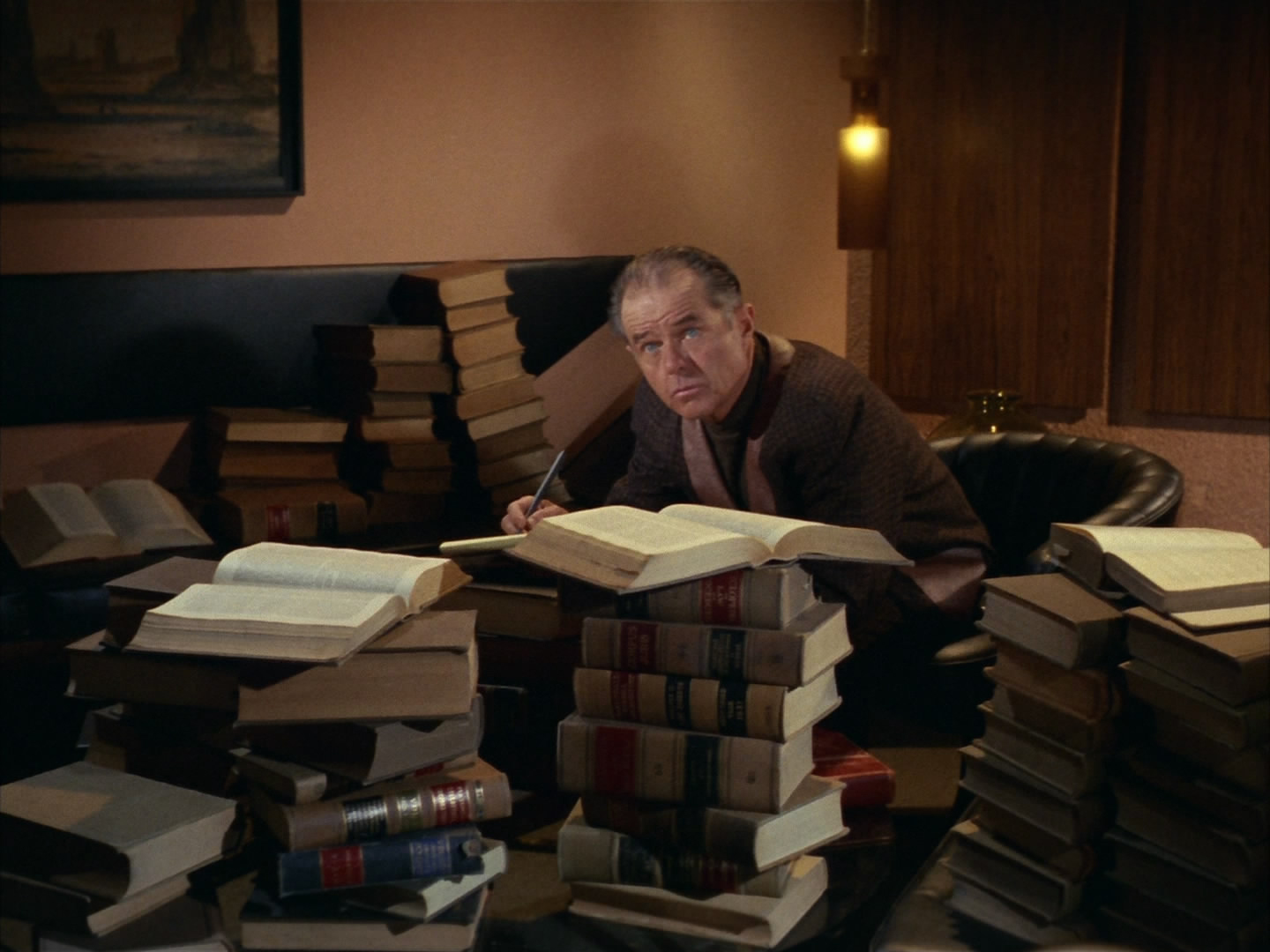 Cogley surrounded by books.jpg