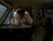 Janeway looks through Lada window