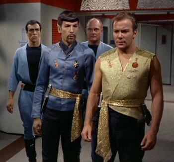 Spock and James T. Kirk with guards in 2267.