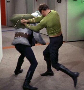 Thelev in close combat with James T. Kirk
