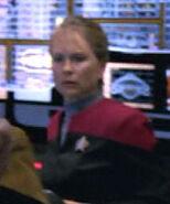 Female relief conn officer on the bridge