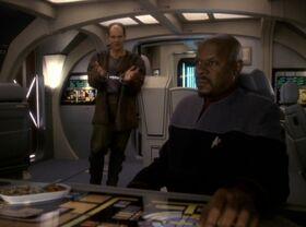 Sisko and Eddington talking aboard a runabout.jpg