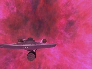 USS Enterprise leaving galactic barrier, remastered.jpg