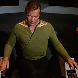 Kirk wearing green wraparound tunic, collar rank.jpg