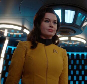 Romijn dressed in a Starfleet uniform