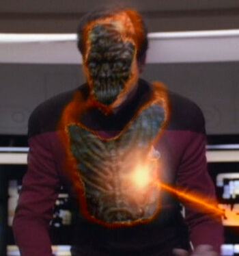 The deception is revealed by a phaser blast