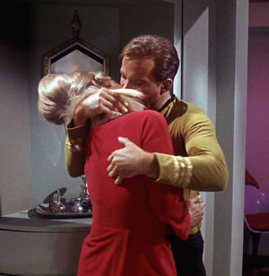 James Kirk forcefully grabs Janice Rand.jpg