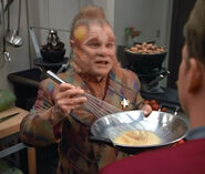 Neelix preparing scrambled eggs