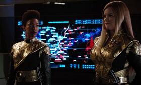 Burnham and Tilly dressed in Terran uniforms.jpg