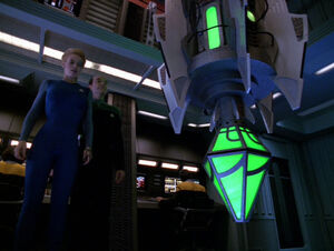Seven and The Doctor look at the Borg vinculum.jpg
