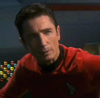 Malcolm Reed wearing a Starfleet uniform from the future