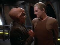 Quark eagerly inquires about Sisko's answer