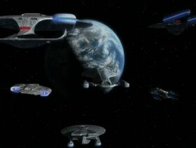 USS Voyager escorted home.jpg