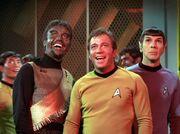 Kang, Sulu, Kirk, Spock in engineering