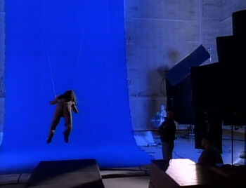 "Hatem filming the episode ""Night Terrors"" in front of a blue screen"