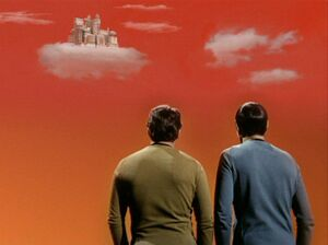 Kirk and Spock view Stratos from surface.jpg
