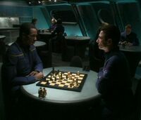 Controlled by aliens, Malcolm and Travis play chess