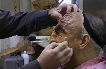 Quashnick's hands applying makeup to Martok actor J.G. Hertzler for <i>Star Trek: Deep Space Nine</i>