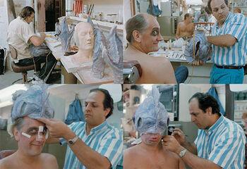Apone applying makeup prosthetics on Mick Fleetwood