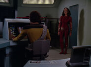 Worf and K'Ehleyr in the tactical room of the Enterprise-D