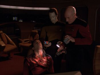 Picard and Data discover the corpse of Dern