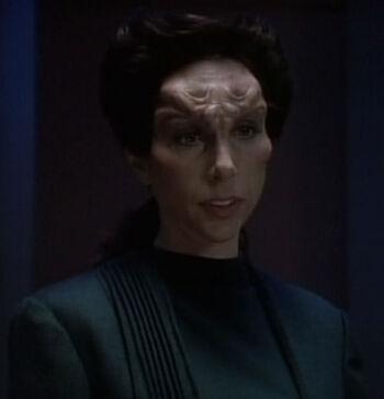 Parker as Dr. Tava