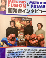 Sakamoto, Yamamoto and Tanabe with models of Samus and SA-X