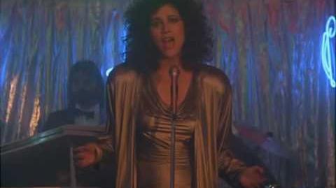 Saundra Santiago (as Gina Calabrese) sings