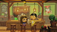 A Mage and a Cat Mii sitting in the Cafe