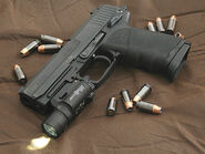 HK USP 45 surrounded by 45 caliber Hornady TAP (+P) jacketed hollow point rounds