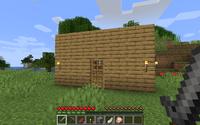 Une maison dans une plaine.
